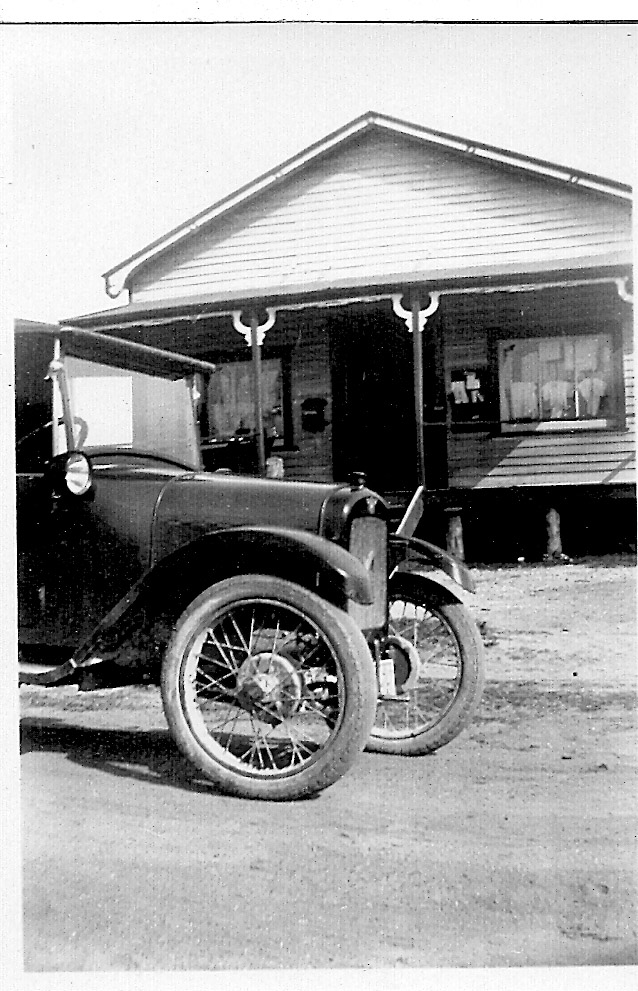 Grace's car Austin 7 bedpan outside shop