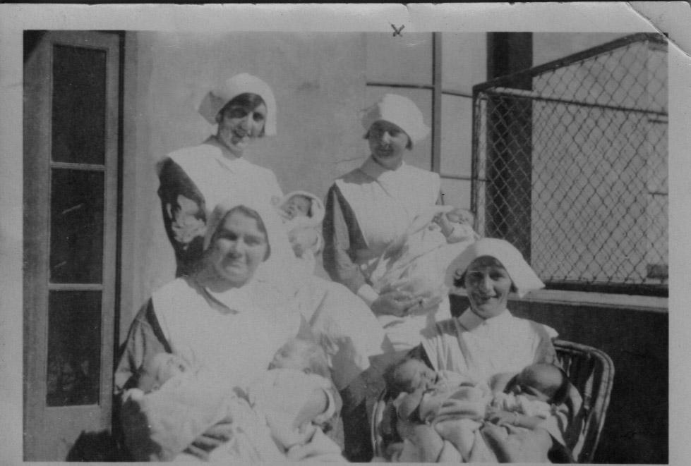 Nurse Grace Slapp (back right)